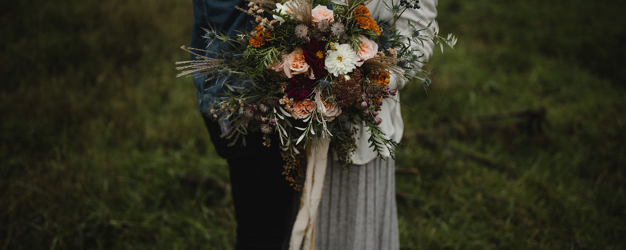 Couple eloping with bride holding bridal bouquet