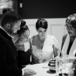 Black and white photo of an intimate wedding ceremony